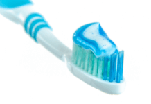 Blue bristle toothbrush with blue toothpaste