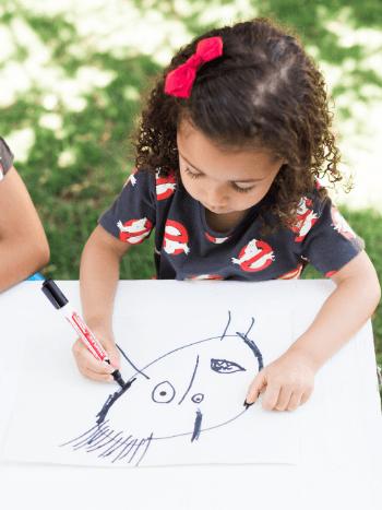 Preschool child drawing scary monster art