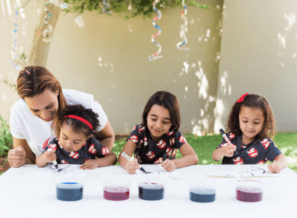 Children with their mom painting monsters