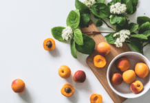 Fresh peaches on counter with mint leaves