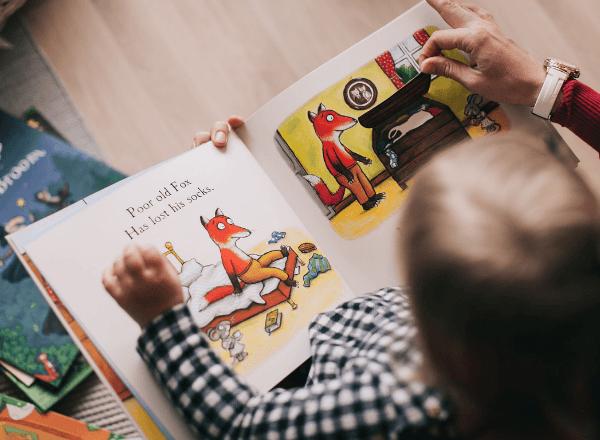Preschooler reading book about a fox