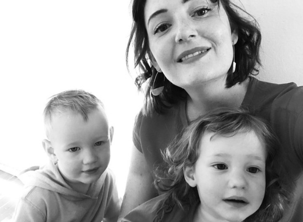 Smiling mom with toddler twin boys