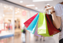 Woman carrying coloured shopping bags