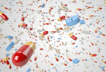 Antibiotic pills and capsules flying around