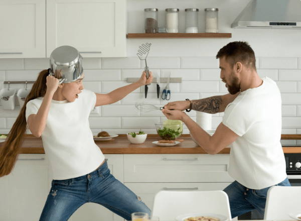 Husband and wife fighting over household chores