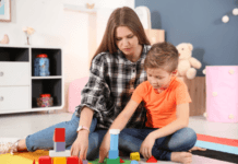 Mom playing blocks with her autistic son