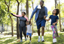 Healthly family jogging through a park