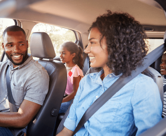 Happy family travelling safely in a car