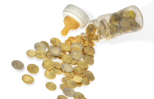 Baby formula bottle filled with coin money