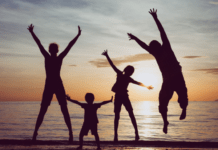 becoming a stepparent when you don't have children of your own: happy family at the beach
