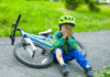 Boy crying after falling off his bicycle