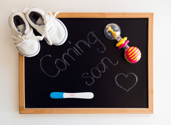 Coming soon baby announcement on chalkboard