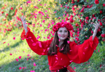 Happy lady in red shirt with red petals