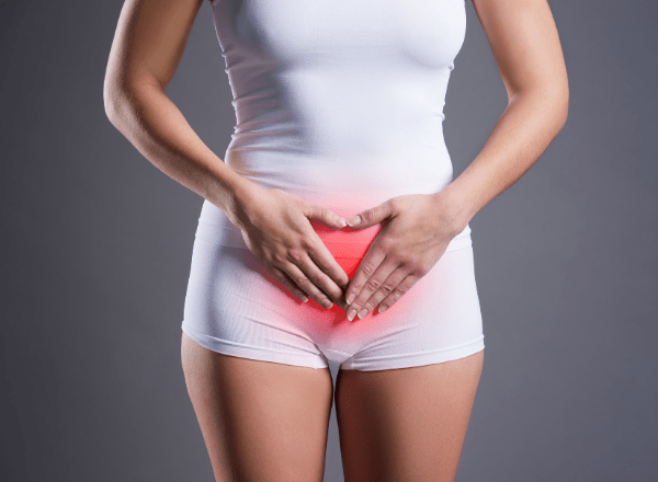 woman with endometriosis holding her painful abdomen
