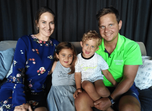 Parents with children sitting happily on couch