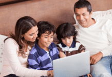 Happy family working on tech laptop