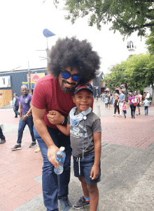 AfroDaddy with son Liam outside shopping area