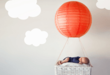 Hot air balloon and clouds above baby
