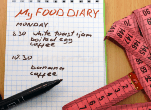 Food diary with measuring tape and pen