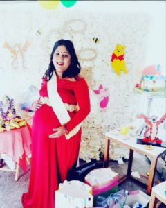 Pregnant woman in red at baby shower