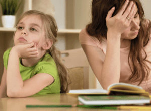 Upset mom and daughter fighting over homeschooling