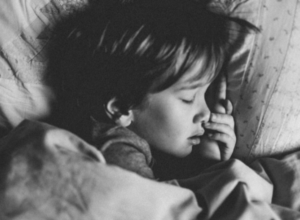 Black and white picture of sleeping preschooler