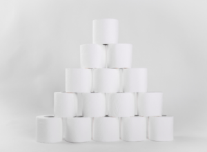 Toilet paper rolls stacked in a pyramid