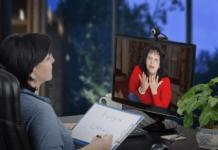 Psychologist conducting virtual therapy session from home