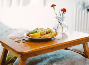 Breakfast with roses served on wooden tray