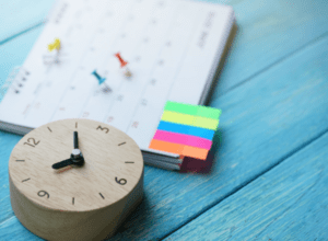 Calendar with clock and colourful sticky notes