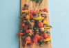 Veggie skewers on a wooden cutting board