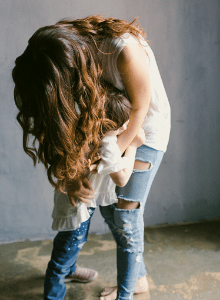 Woman with long hair hugging her child