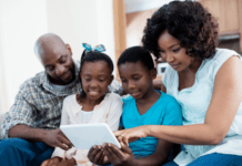Parents showing kids how to use internet