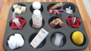 Muffin tray filled with various household items