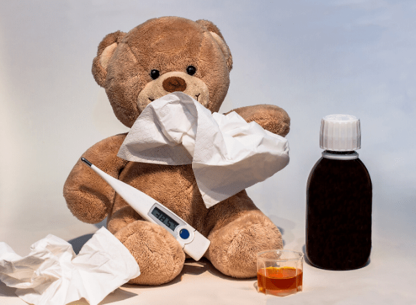 Teddy with tissues and thermometer and medicine