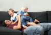 Roughhousing play rough and tumble between a father and his children
