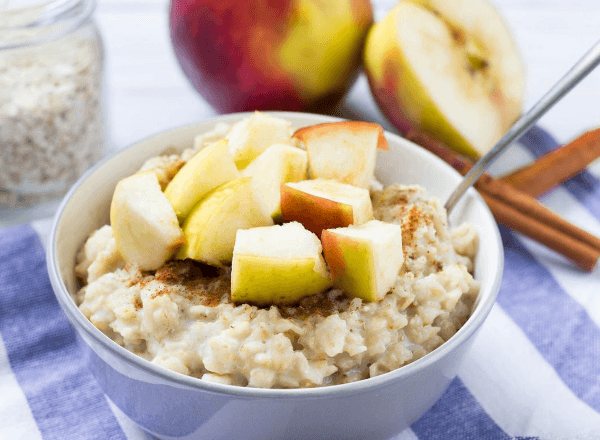 Healthy warm oats with apple and cinnamon