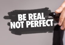 sign reading 'be real, not perfect' for celebrities who refuse to be ashamed of their imperfect bodies