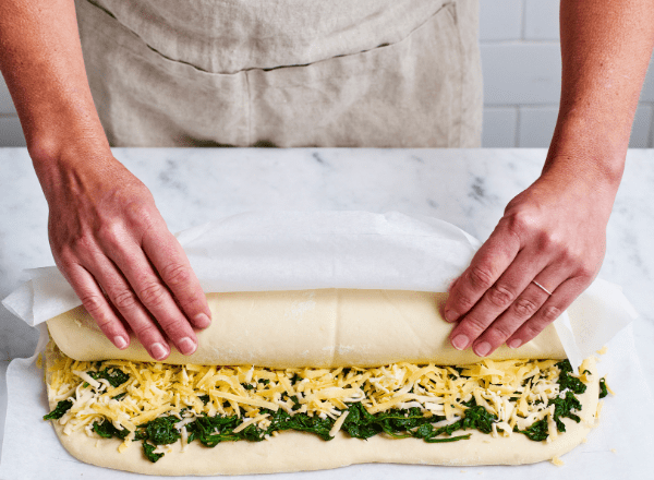Rolling the dough for spinach and cheese pull-apart bread recipe