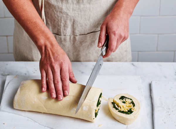 Cutting the dough for pull apart spinach and cheese bread recipe