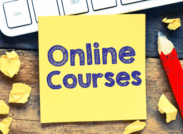 Laptop with a post it saying online courses for people to retrain or upskill for free online