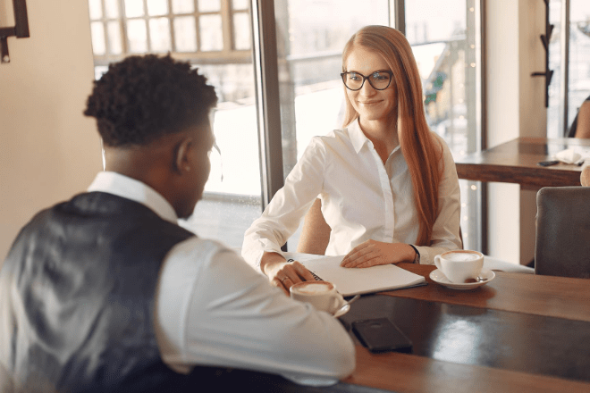 man and woman in job interview situation