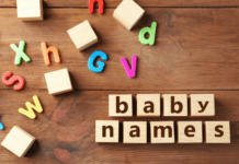 Wooden board with baby names written on it