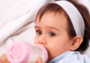 choking hazards in babies and kids: baby drinking milk from a bottle
