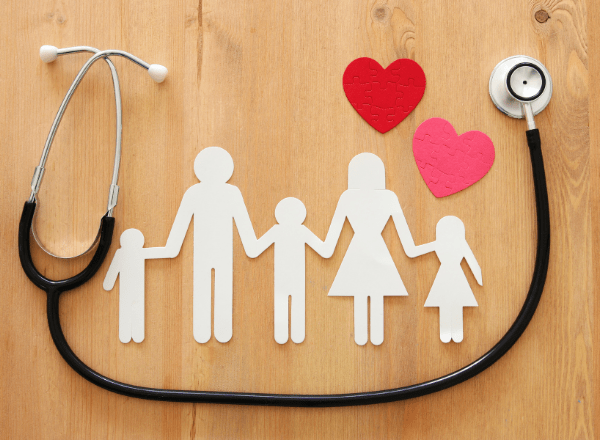 medical aid vs health insurance: family of three made out of paper with a stethoscope