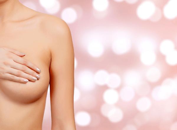 breast milk jewellery: woman covering her breast