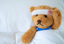 head injury in children: teddy bear with a bandage on his head