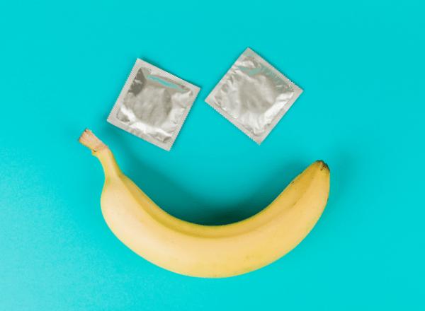 smiley face made using condoms and a banana