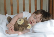 transitioning your toddler from two naps to one: sleeping child