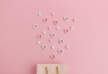 must haves: shopping bag with hearts coming out of it